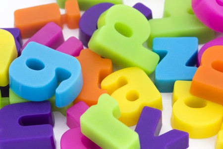 close up background of multicolored magnetic letters photo