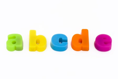 colorful magnetic fridge magnet letters on a white background
