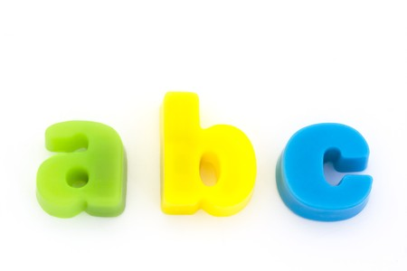 abc green yellow and blue magnetic letters on white Stock Photo - 6992782