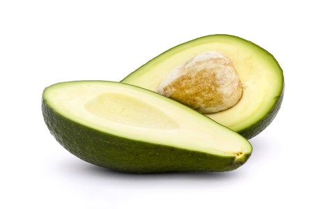 avocado cut in half with stone isolated on white Stock Photo