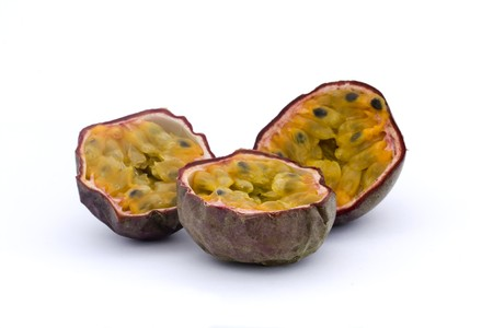 three halves of passionfruits isolated on white