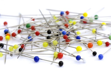pins on a white background
