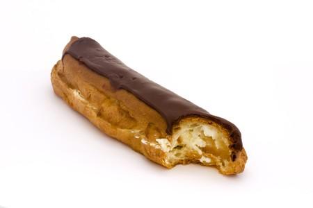 chcolate eclair witha bite taken on a white background Stock Photo - 7011257