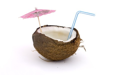 open coconut with straw and umbrella over white Stock Photo