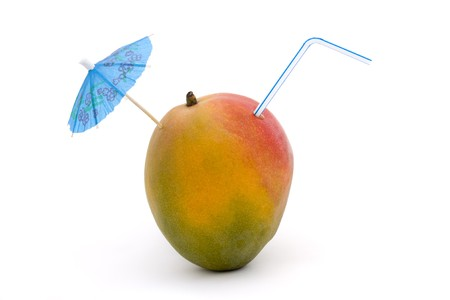 ripe mango with straw and umbrella on a white background