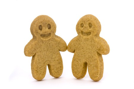 two plain gingerbread men on a white background photo