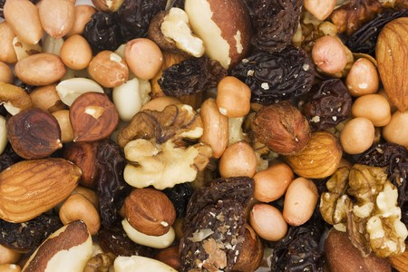 background of assorted mixed nuts and dried fruits