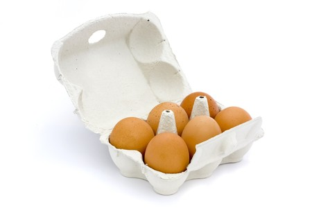 6 eggs in a box isolated on a white background photo
