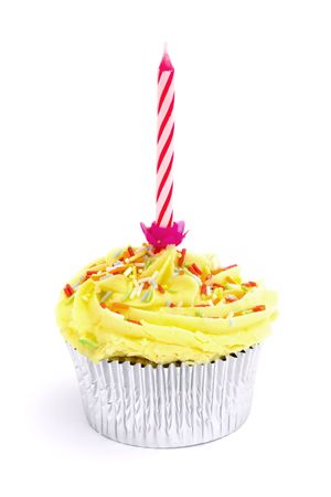 yellow cupcake with candle on a white background