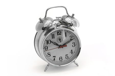 silver alarm clock on a white background