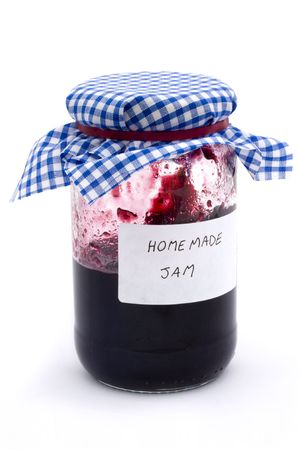 jar of homemade jam on a white background