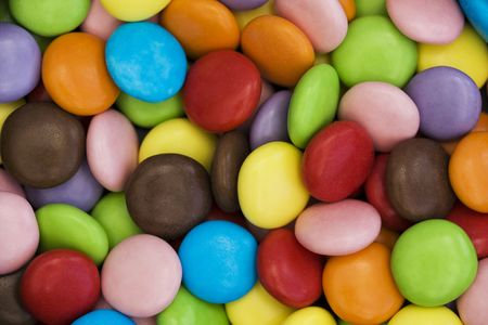 background of colorful candy coated chocolate sweets