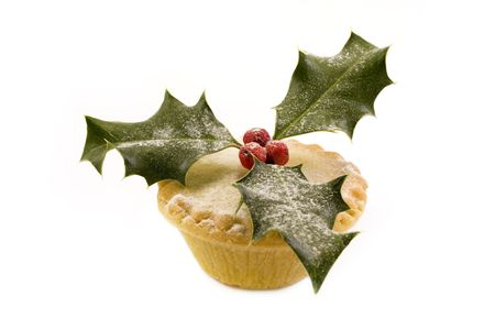 single mince oie decorated with holly over white