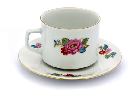 floral tea cup and saucer on a white background Stock Photo