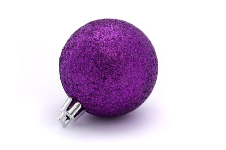 glitting purple christmas bauble over white