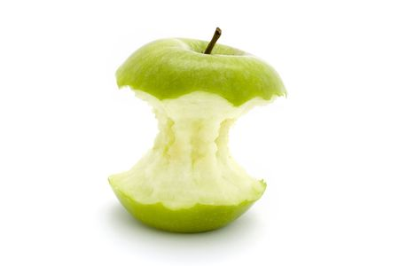 green apple core on a white background photo