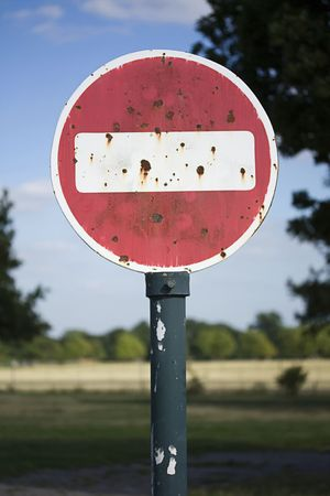 rusty no entry sign in a field Stock Photo