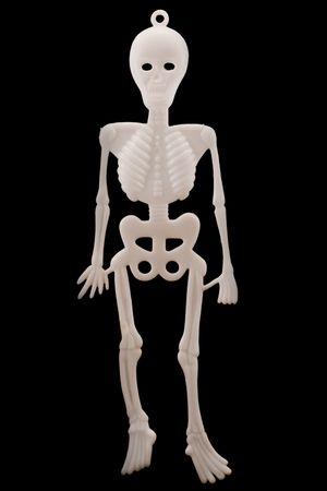 white plastic skeleton isolated over black Stock Photo