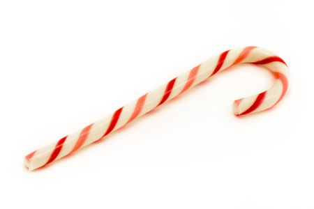 red and pink striped candy cane isolated over white