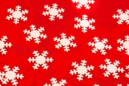 background of white snowflakes over red