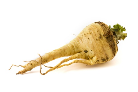 Single parsnip isolated on a white background