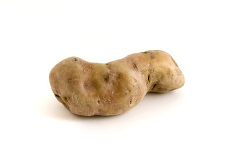 Single misshapen potato isolated on a white background