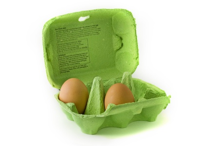 two and a half: Two eggs in a green egg carton over white Stock Photo