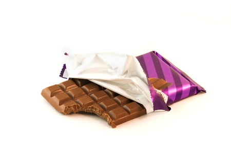 Chocolate bar isolated on white with a missing bite in the wrapper photo