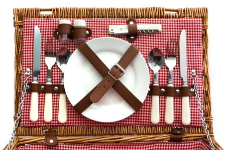 checker plate: Old fasioned wicker picnic basket with cutlery