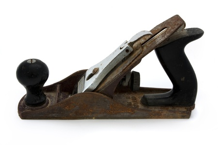 Old rusty wood plane isolated on white
