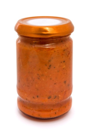 Glass jar of tomato sauce isolated on white