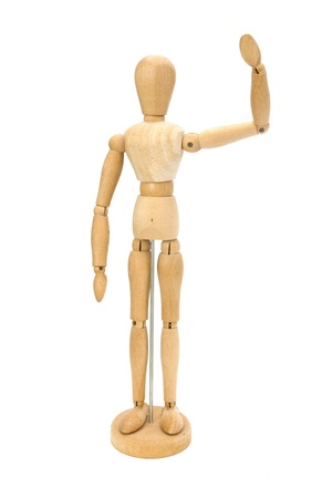 Waving wooden artists Mannequin over white photo