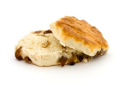 Sliced fruit scone isolated on white