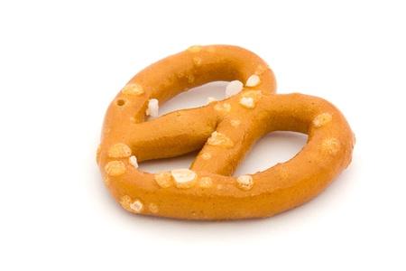 Single salted pretzel isolated on white