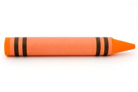 Single orange crayon isolated on a white background