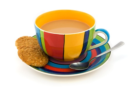 Stripy cup and saucer with two biscuits isolated on white