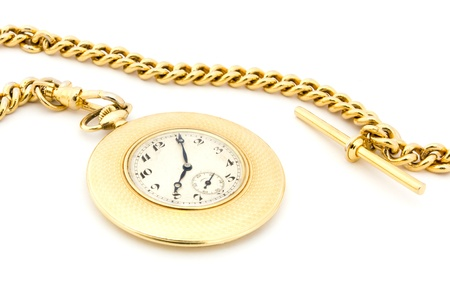 Gold pocket watch on a chain over white Stock Photo - 9949214