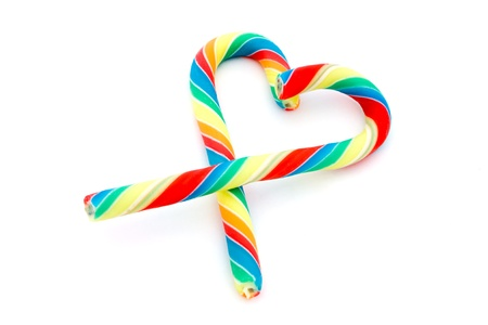 Colourful candy cane heart over white