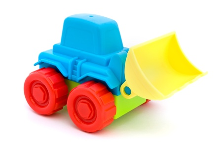 Colorful toy tractor isolated on a white photo