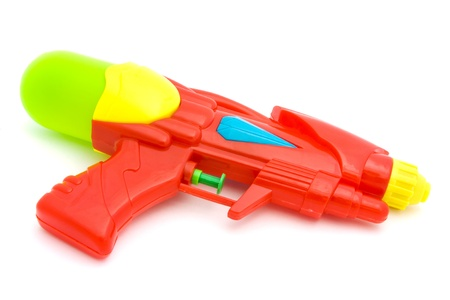 plastic toys: Plastic water gun isolated over white