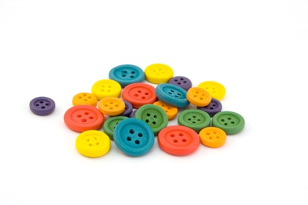 haberdashery: Pile of colorful buttons isolated on white