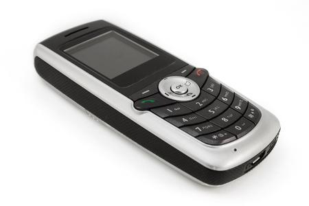 old technology: Vecchio telefono cellulare isolato su bianco