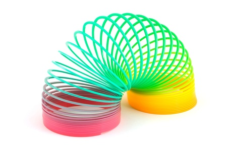 springy: Slinky toy isolated on white Stock Photo