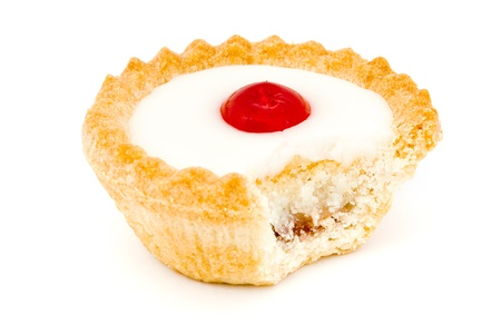 missing bite: Bakewell tart with a missing bite over white Stock Photo
