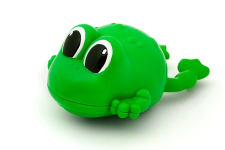 Green plastic bath toy frog over white