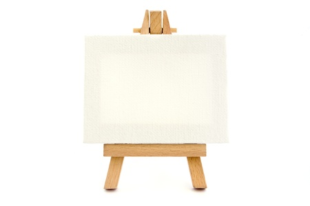 Small easel with a blank canvas over white Stock Photo - 13043086