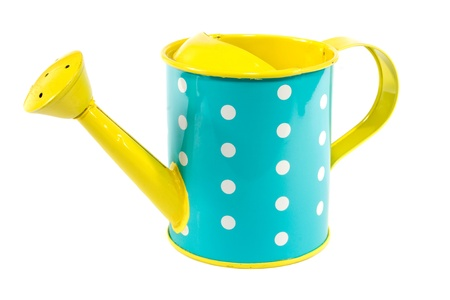 Blue and yellow polkerdot watering can on white