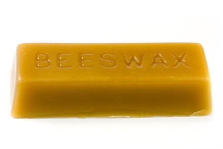beeswax: Stick of beeswax over white
