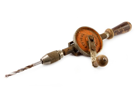 tool chuck: Old rusty hand drill over white Stock Photo