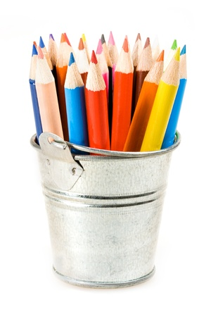 Silver pot of crayons over white
